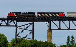 Two locomotives on a tall bridge Stock Image
