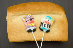 Two lollipop candy pirate. On bread close-up Royalty Free Stock Photography