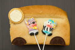 Two lollipop candy pirate. On bread close-up Stock Photography