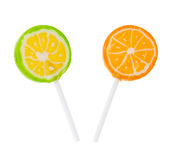 Two lollipop flavored with lime and orange Royalty Free Stock Photography
