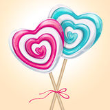 Two lollipop heart shaped tied by ribbon Royalty Free Stock Photo