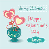 Two lollipop hearts in a vase with an inscription love on the vi Stock Image