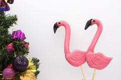 Lollipops in the form beautiful flamingo and small Christmas tree royalty free stock image