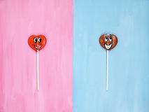 Two lollipops on pink and blue background. Love concept. Valentines day Royalty Free Stock Image