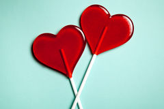 Two lollipops. Red hearts. Candy. Love concept. Valentine day. Two lollipops. Red hearts on blue background. Candy. Love concept. Valentine day Stock Photography