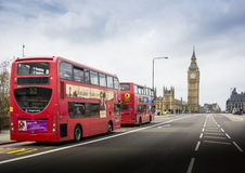 Two London Buses with Big Ben in London, England Royalty Free Stock Image