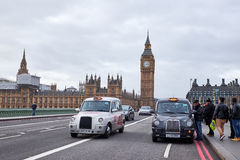 Two london cabs on westminster bridge Royalty Free Stock Images