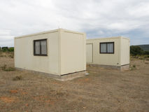 Two lonely bungalows on the Way of St. James in Spain. Near the way of St. James: Two lonely bungalows on barren earth Stock Image