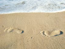 Two lonely footprints in the sand Stock Photos