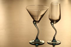 Two lonely glasses in twilight. Empty glasses for wine on a beautiful leg Stock Images