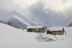 Two lonely houses in the snow Stock Photography
