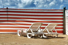 Two long chairs on Belgian coast Royalty Free Stock Photo