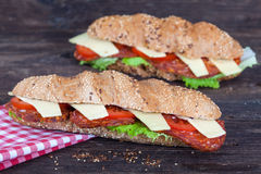 Two long ciabatta sandwiches stock photo