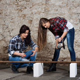 Two long-haired young woman with an angle grinder Stock Photos
