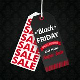 Two Long Price Stickers Black Friday Wallpaper Ornaments. Two long price stickers for black friday on the dark background with ornaments Royalty Free Stock Image