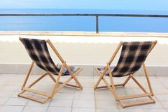 Two longes on veranda on sea Stock Images