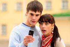Two look at cellular telephone Stock Photos