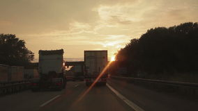 Two lorries, trucks, one overtaking the other stock video footage