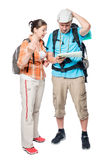 Two lost tourists look at the map on a white background. In the studio Royalty Free Stock Image
