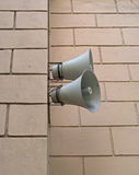 Two loudspeakers. Two speakers are installed on a wall of a building Royalty Free Stock Images