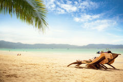 Two lounge chair at tropical beach Royalty Free Stock Photos