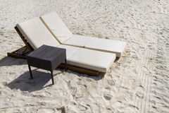 Two Lounge Chairs. A pair of beach lounge chairs with table Stock Photography