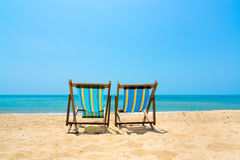 Two lounge chairs on the beach Royalty Free Stock Image