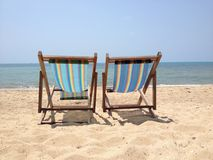 Two lounge chairs on the beach Royalty Free Stock Images