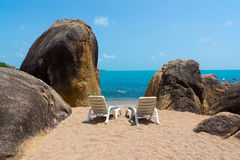 Two lounge chairs on the beach Stock Photo