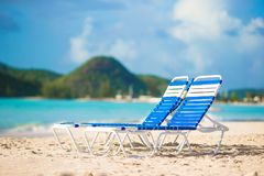 Two lounge chairs on beautiful tropical beach at Maldives Stock Photo