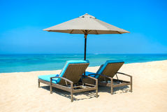 Two lounge chairs with sun umbrella Royalty Free Stock Image