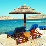 Two lounge chairs with sun umbrella on a beach Stock Photography