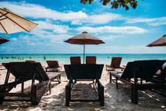 Two lounge chairs with sun umbrella on a beach. Tropical island Phu Quoc Royalty Free Stock Photography