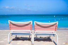 Two loungers on the exotic resort at white sand Royalty Free Stock Photography