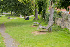 Two loungers to relax in the park. Stock Photo