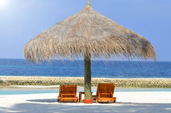 Two lounges on a beautiful white beach Royalty Free Stock Image
