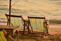 Two lounges by sea Royalty Free Stock Photos