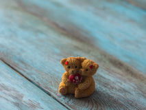 Two love bears on wooden background. Free space for text. Stock Images