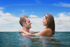 Two love birds in the sea Stock Photos