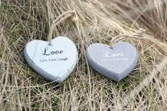 Two love hearts on sand dunes Royalty Free Stock Photo