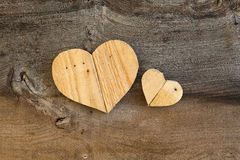 Two Love Valentines wooden hearts on old Elm background Stock Photos