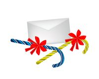 Two Lovely Candy Canes with Red Bow and Letter Royalty Free Stock Photography