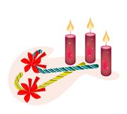 Two Lovely Candy Canes and Three Christmas Candles Stock Images