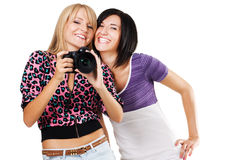 Two lovely friends with a camera Royalty Free Stock Image