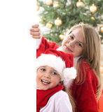 Two lovely girl holding white board Stock Images