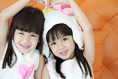 Two lovely girl use hand cover and touch to make heart sign toge Royalty Free Stock Photos