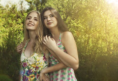 Two lovely girls an embrace stay on the nature. Lovely girls an embrace stay on the nature Royalty Free Stock Images