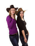 Two lovely looking girls in hats smoking Royalty Free Stock Images