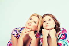 Two lovely pensive girls Stock Photos