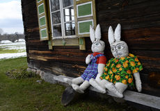 Two lovely rabbit dolls sitting near window. Ethnographic museum in Lithuania. Rumsiskes, Lithuania Royalty Free Stock Photography